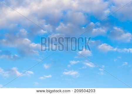 clouds in the blue sky . In the park in nature