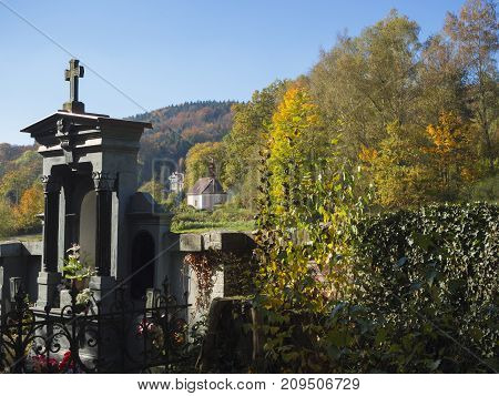 Family Vault Tomb In Village Cemetery With View On Autumn Landscape And Baroque Chapel In Luzicke Ho