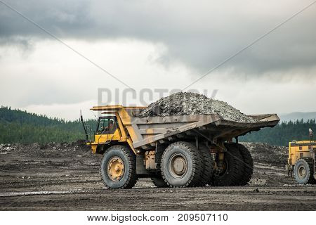 Production useful minerals. the dump truck yellow