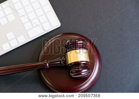 Top view, flat lay. Close up on a black background. copy space for text, selective focus. justice and law concept.Lawyer workplace with laptop and documents with dark wooden