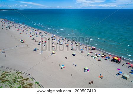 Italy, the beach of the Adriatic sea. Rest on the sea near Venice. Aerial FPV drone photography.