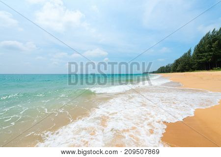 Seascape With Deserted Sand Beach And White Waves