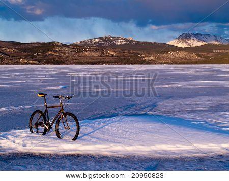 Bike on frozen Lake Laberge, Yukon, Canada