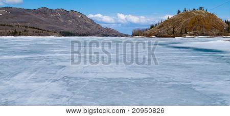 Skiing on Frozen Lake Laberge, Yukon, Canada
