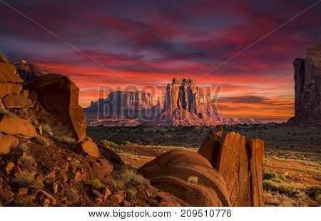 Stunning sunrise under a dramatic sky in Monument Valley,