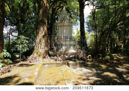 Chiang Mai Thailand - March 25 2017 : Ancient stupa at Doi Inthanon against beautiful green nature background in Thailand.
