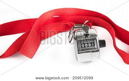 Metal Clicker Counter on red ribbon isolated on white