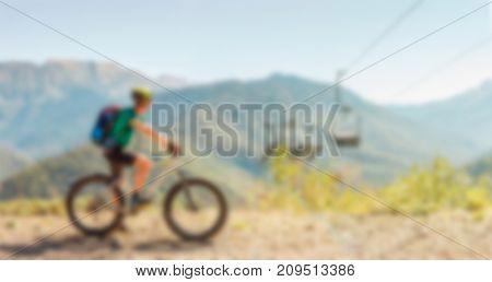 Image of man in helmet on bicycle