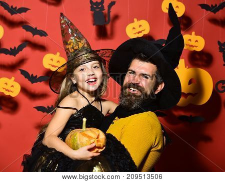 Father And Daughter In Costumes. Halloween Party And Celebration Concept.