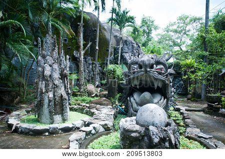 Stone dragon in the tropical jungle, fountain, sculpture,