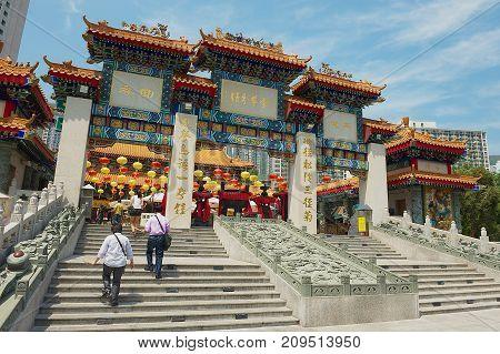 HONG KONG, CHINA - SEPTEMBER 14, 2012: Unidentified people enter Sik Sik Yuen Wong Tai Sin temple at Kowloon in Hong Kong, China.