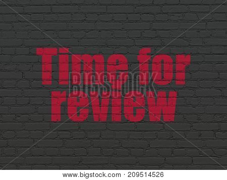 Time concept: Painted red text Time for Review on Black Brick wall background