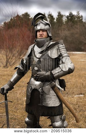 Knight In Armour After Battle On Forest Background
