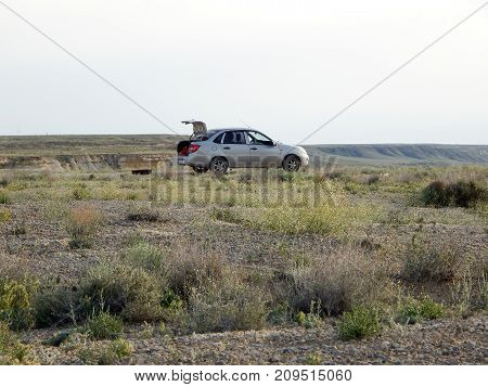 Car in the steppe. Rest at nature. Kazakhstan.