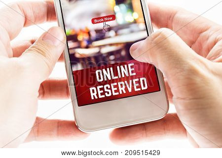 Close Up Two Hand Holding Mobile Phone With Online Reserved Word And Icons, Digital Marketing Concep