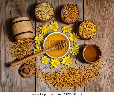 beekeeper's still life with yellow flowers on wooden background