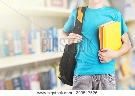 Boy school book teen schoolbag close-up happy