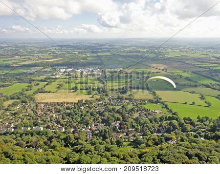 Paraglider flying from the Malvern Hills, Worcestershire