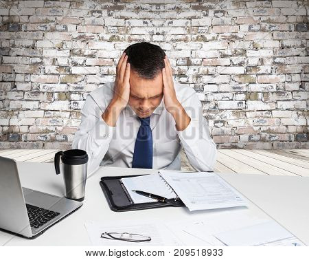 Business man stress table break computer customer
