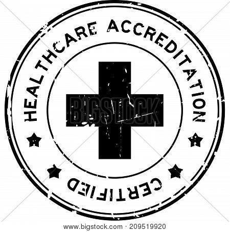 Grunge black healthcare accreditation round rubber seal stamp on white background