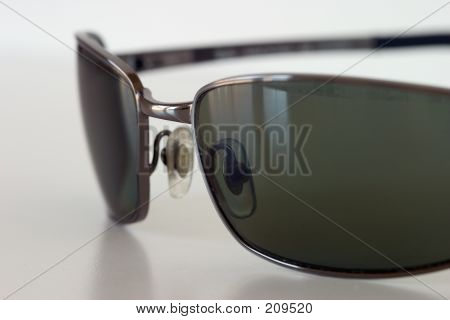 Sunglasses On A White Surface