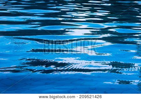Reflection Of Sky On The Moving Water Surface In The Pool