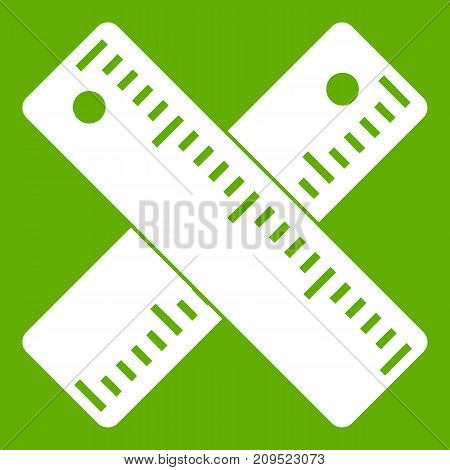 Two crossed rulers icon white isolated on green background. Vector illustration