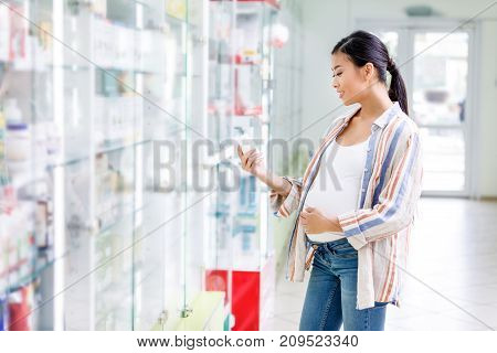 Pregnant Woman Buying Medication