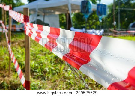 Red And White Tripped Tape Fence For Barricades Or Murder Zones Or Crime Scene.