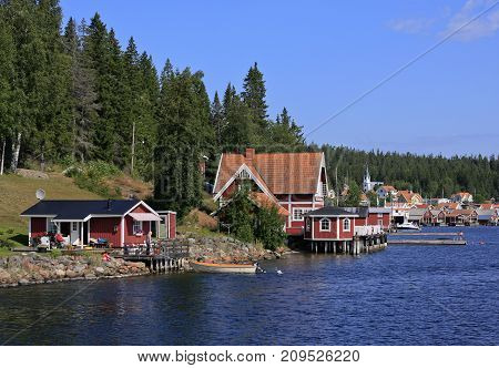 ULVON, SWEDEN ON AUGUST 06. View of the inlet to Ulvon village and it´s harbor on August 06, 2009 in High Coast World Heritage. Sweden. Unidentified people ashore. Editorial use.