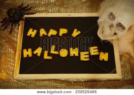 Happy Halloween words decoration with scary skull background
