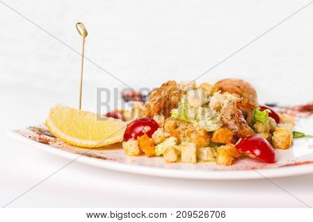 caesar with shrimp salad fresh vegetables on a white background