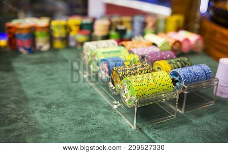 Sofia, Bulgaria - 24, November 2016: Colourful poker chips in a casino on a gambling table. Lots of chips with different nomination and colours.