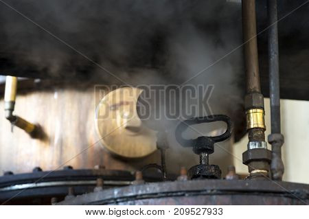 Whiskey and brandy distillery. View of a valve with steam of whiskey stills in a distillery.