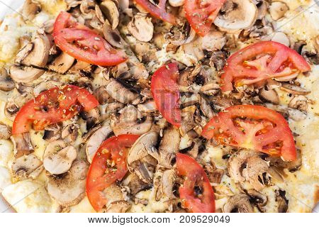vegetarian pizza with champignons mushrooms and tomatoes