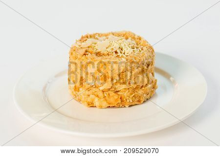 Napoleon Dessert On A Plate On A White Background