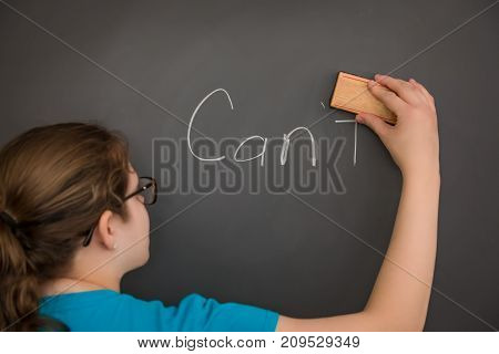 A Teacher erasing the