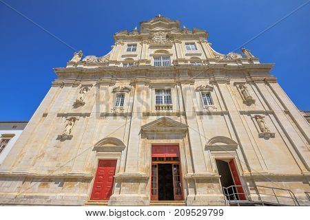 The main facade of the New Cathedral of Coimbra, Se Nova de Coimbra, is a Catholic church of Coimbra in Baroque style. Coimbra is one of the oldest university cities in Europe. Central Portugal.