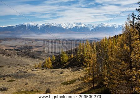 View of the foothills on a background of the mountain North-Chuya ridge of Altai Republic, Russia.