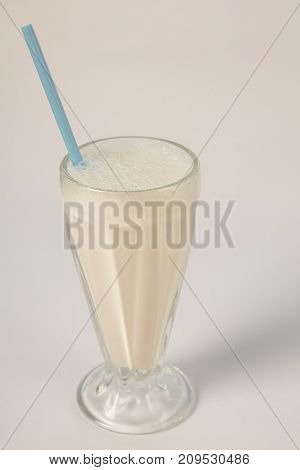 milkshake with straw on a white background