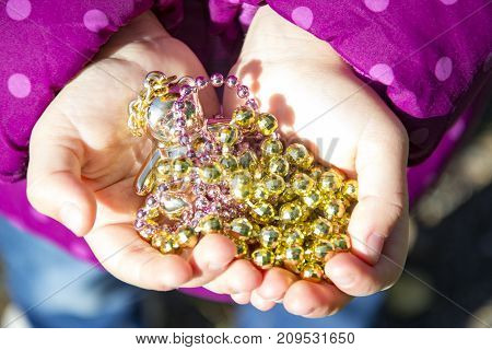Children's hands holding treasure. Kids playing toy