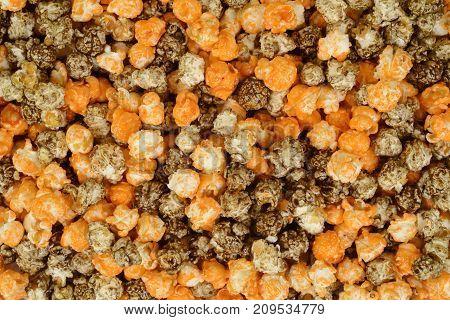 halloween orange and black licorice popcorn making a background