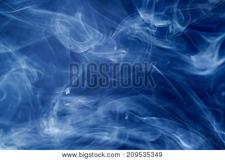 Blue smoke on black. Abstract background and texture
