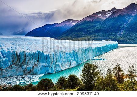 The fantastic glacier Perito Moreno, in the Patagonia. Argentine Province of Santa Cruz, lake Argentine. The concept of exotic and extreme tourism