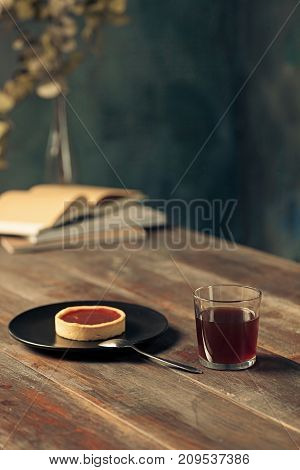 The cake and cup of coffee on wooden table