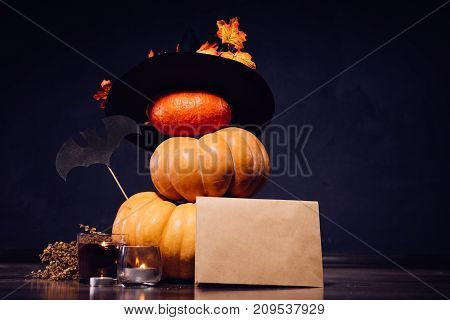 to decorate the house for Halloween are yellow and orange pumpkins and a black witch hat