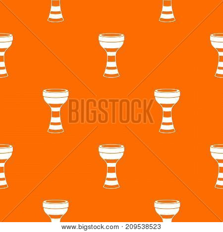 African drum pattern repeat seamless in orange color for any design. Vector geometric illustration