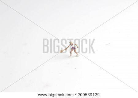 Tiny Toys Play Tennis On White Board