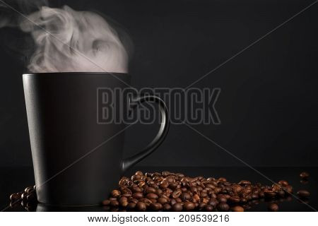Black Cup Of Coffee With Steam On Black