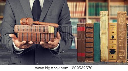 Holding wooden man books gavel background close-up